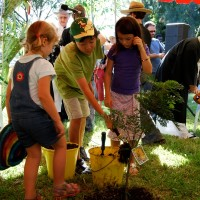 Children of the multicultural community planting the Tree for Peace, Anzac Day 2009